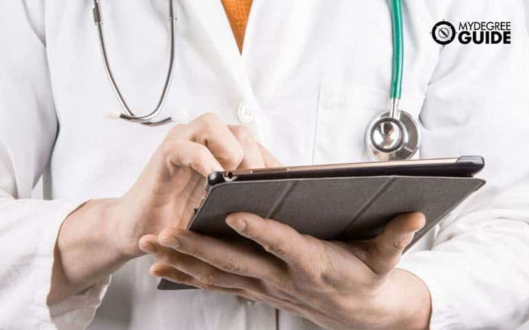 medical doctor with ipad searching for best info