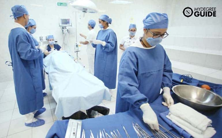 medical students prepare to assist in a university hospital
