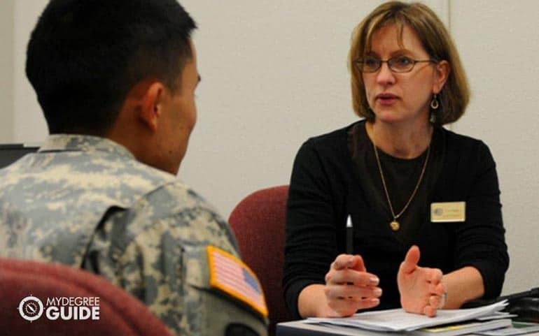 psychologist in session with a military personnel