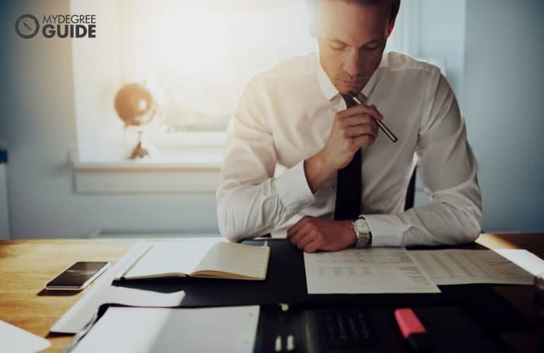 male businessman reviewing financial statements