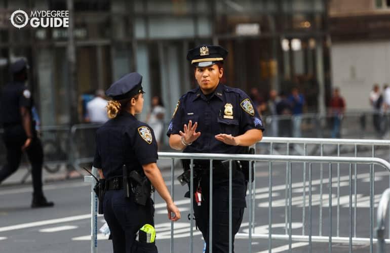 policewomen working in downtown area