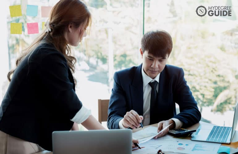 male accountant checking financial statements