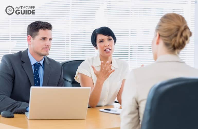 human resource managers interviewing an applicant