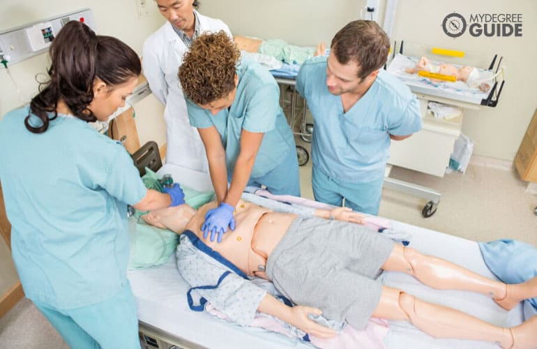 nurses training to do the CPR with the guidance of a doctor