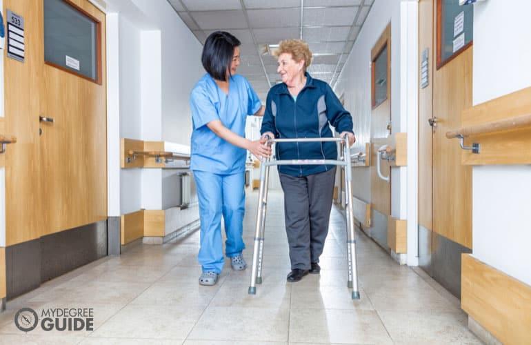female nurse helping an elderly patient