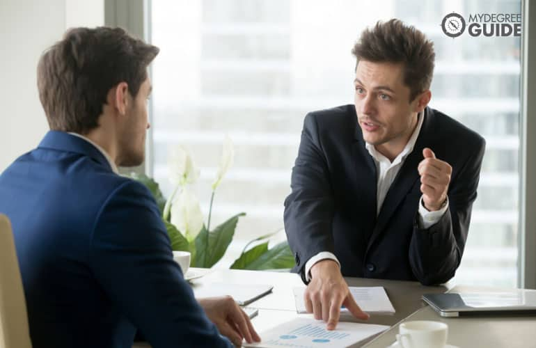 public administration consultant talking to a colleague