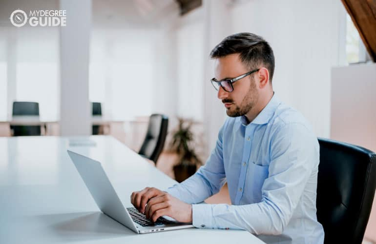 male professional studying on his computer