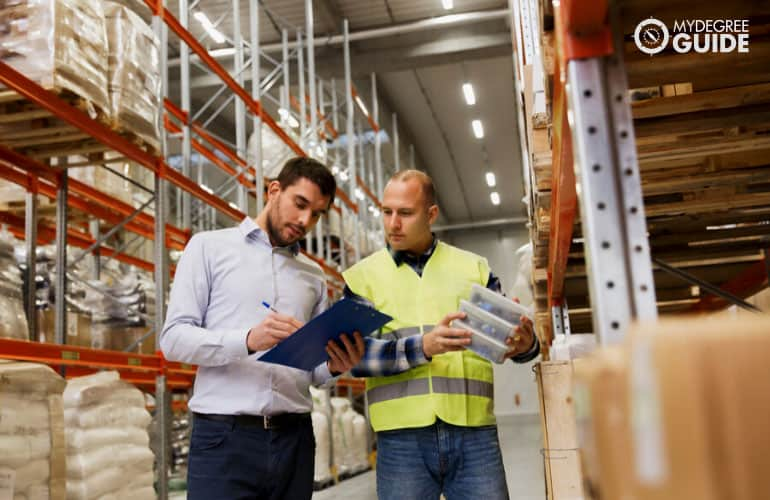 supply chain manager talking to an employee