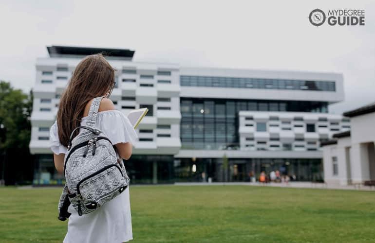 someone walking across campus