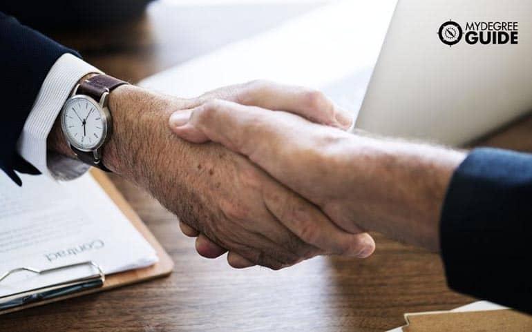 international business partners handshake