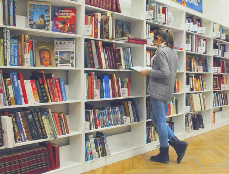 Psychology student standing in library