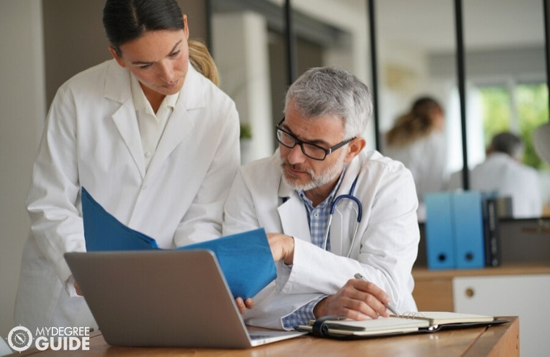 nurse manager consulting a medical doctor in a hospital