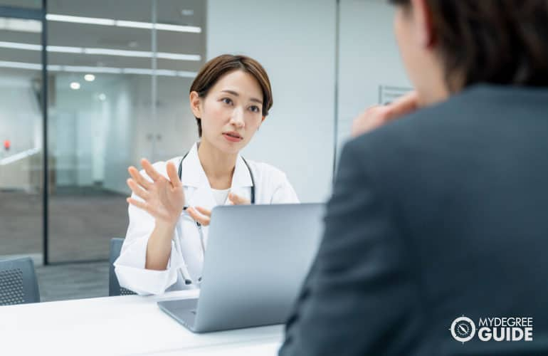 health consultant providing information to a company manager