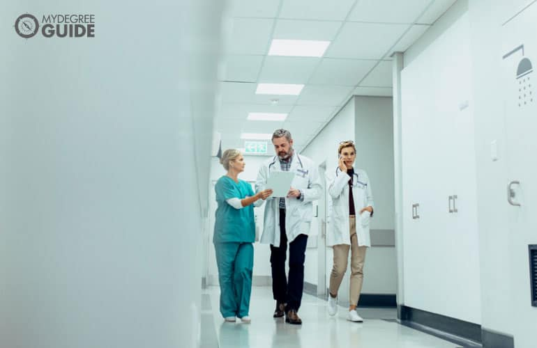 medical staff walking on hospital's hallway