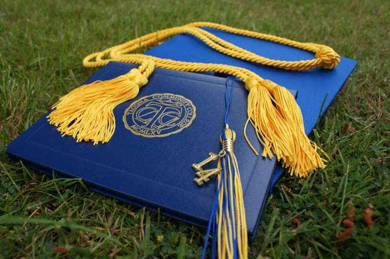 College diploma with honors cords