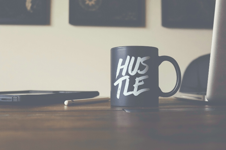 Business office with hustle coffee cup