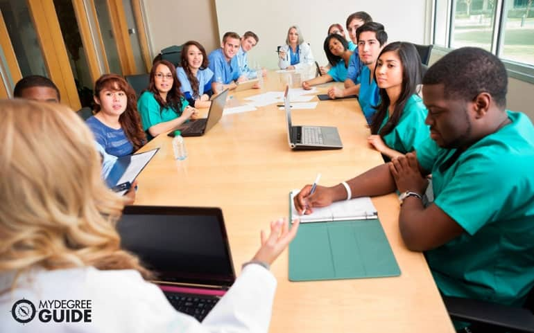 Nurses and doctors sitting in a meeting