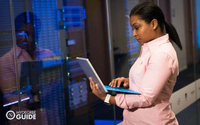 woman with laptop checking mainframe