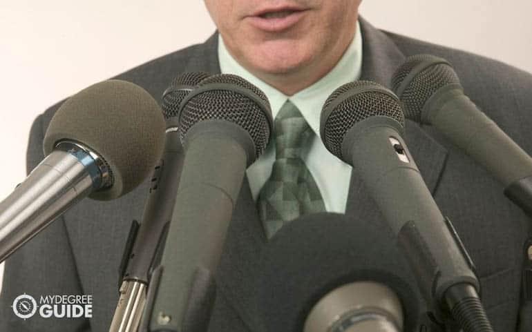 man having a press interview