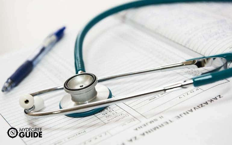 stethoscope on patient record