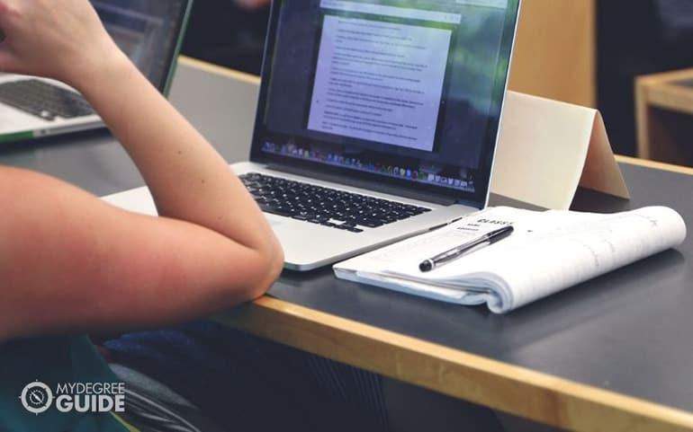 student doing homework on laptop