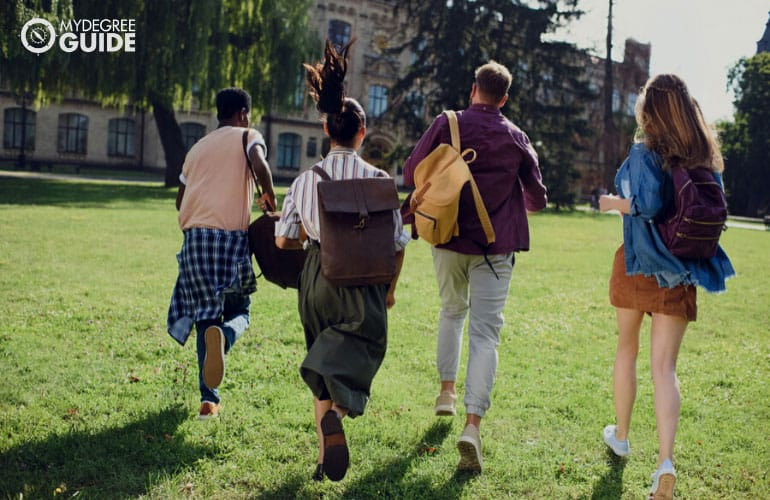 students running across university campus