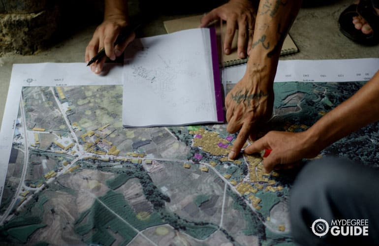 geographer marking maps