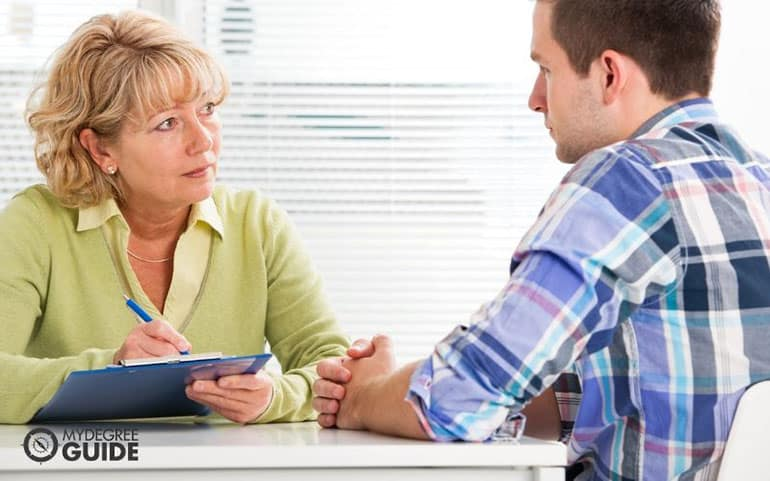 psychologist in a session with a patient