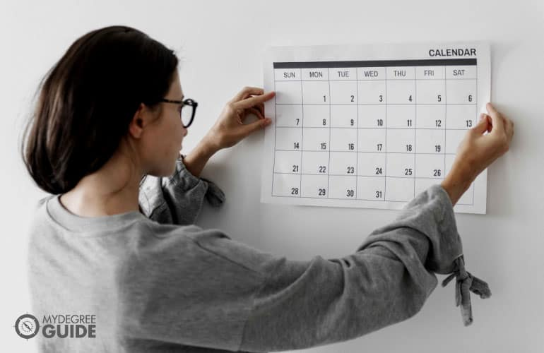 female looking at a calendar