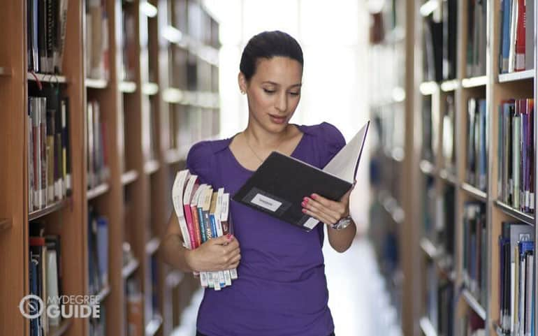 doctorate of education student reading in the library