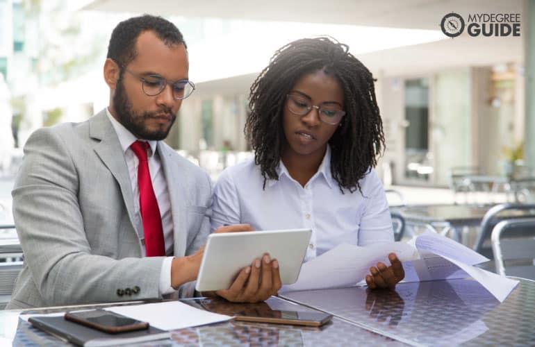 employee consulting a colleague