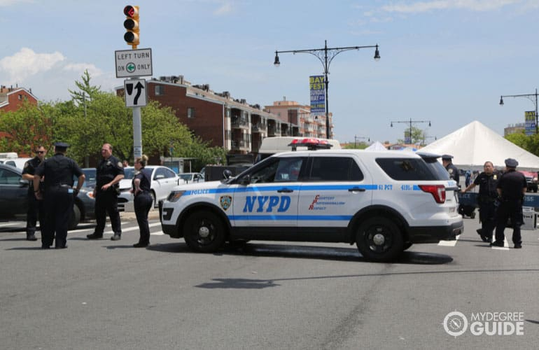 NYPD police car patrolling the area and providing security during Bay Fest street festival in Brooklyn