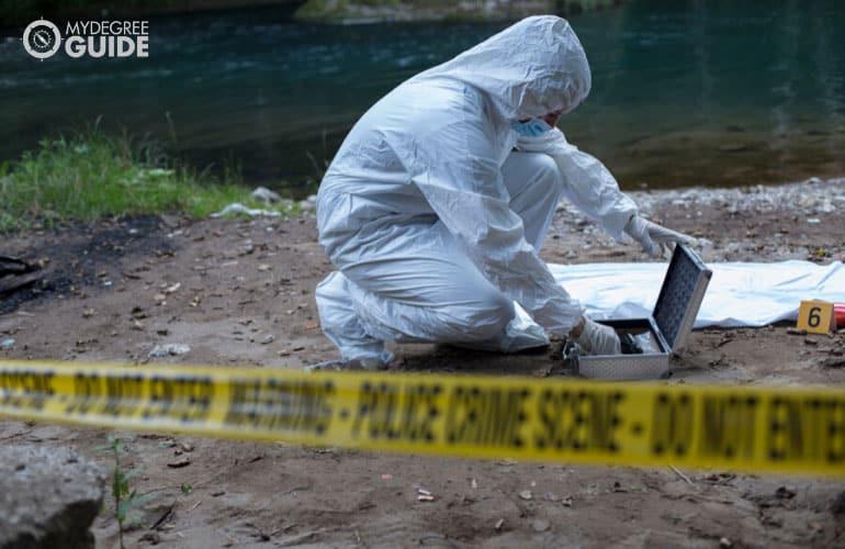forensics expert checking the crime scene
