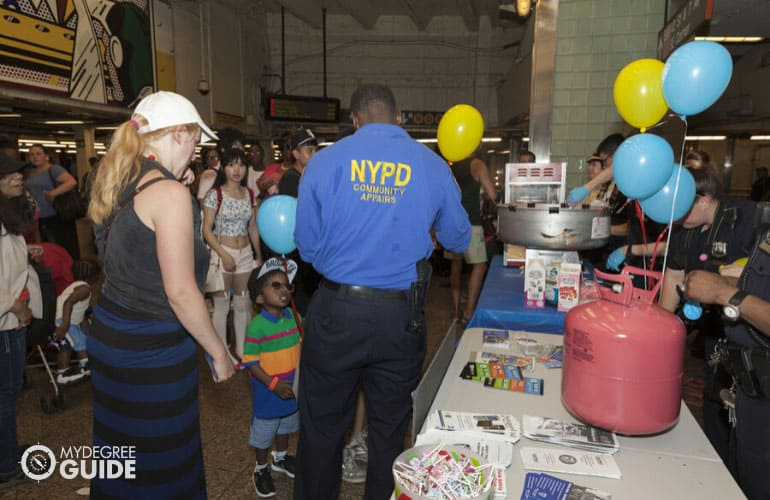 NYPD helping commuters at a subway station