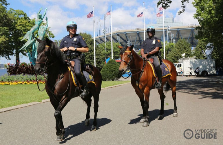 NYPD police officers securing the perimeter on a horseback