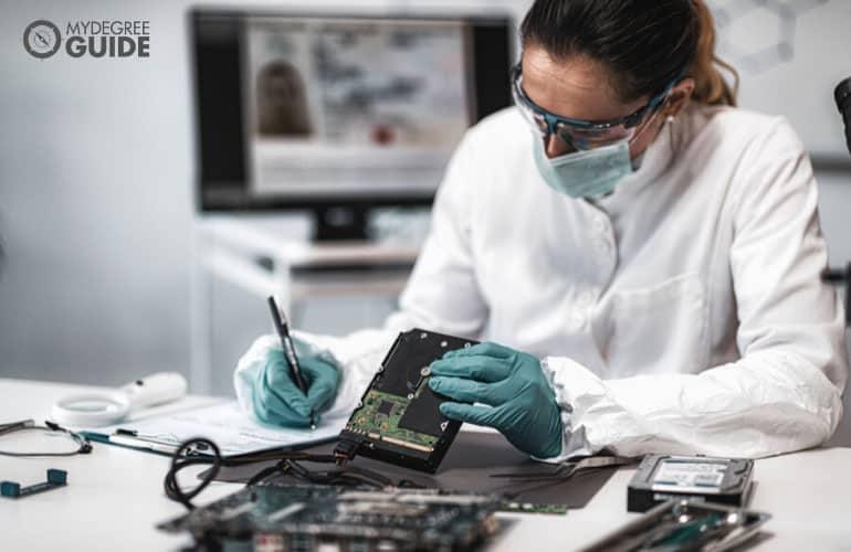forensic science investigator examining evidences