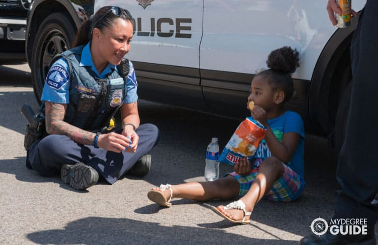 police officer looking after a child