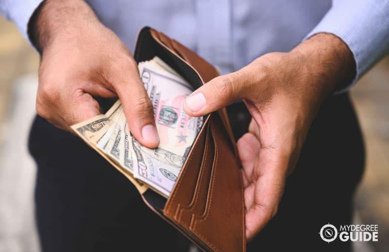 man showing money in his wallet