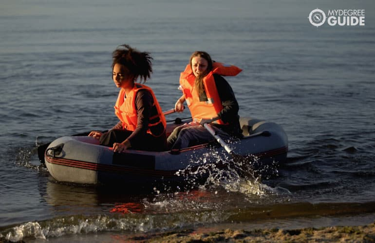 two women on a boat helping the victims during emergency