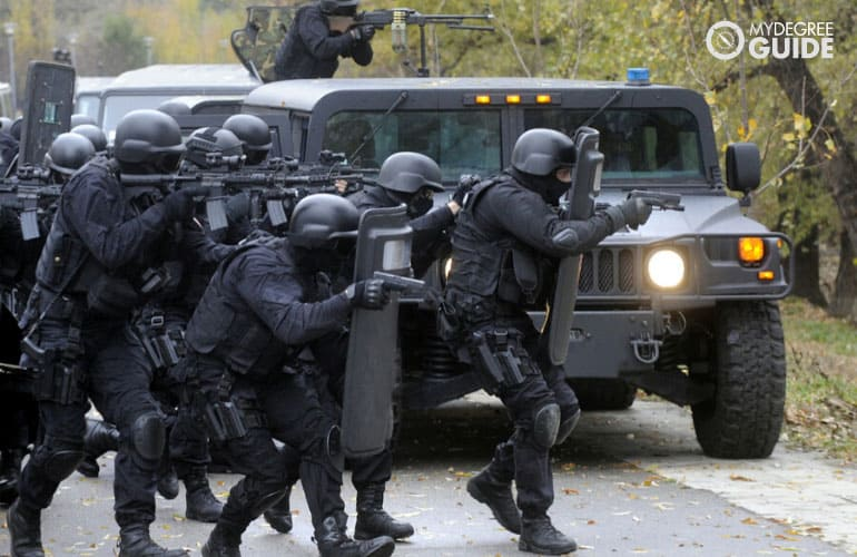 special police forces preparing to infiltrate enemy's base