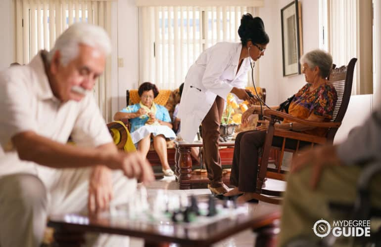 doctor visiting seniors in a nursing home