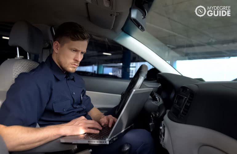 police officer studying on his laptop