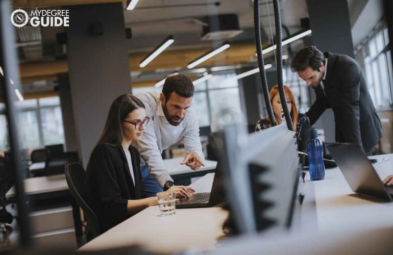 employees planning long-term strategies for company's growth