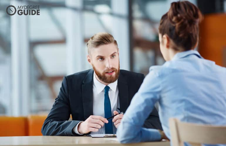 male human resource person interviewing an applicant