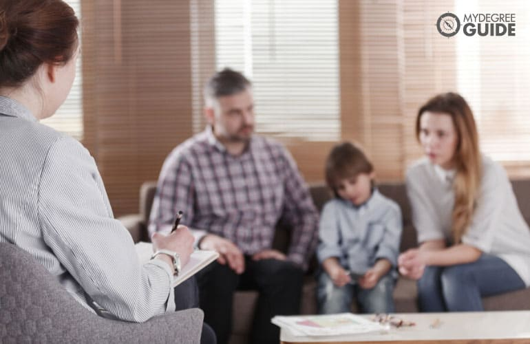 female counselor talking to a family