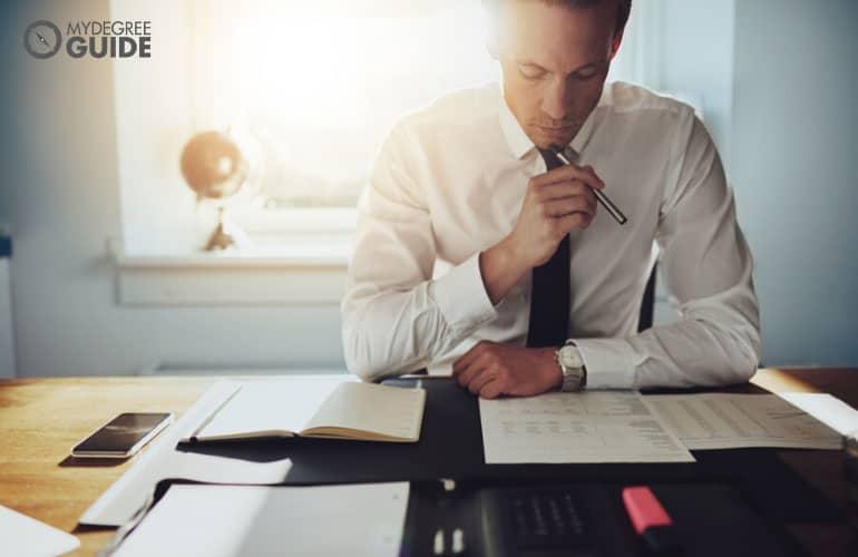 male employee working on finance department