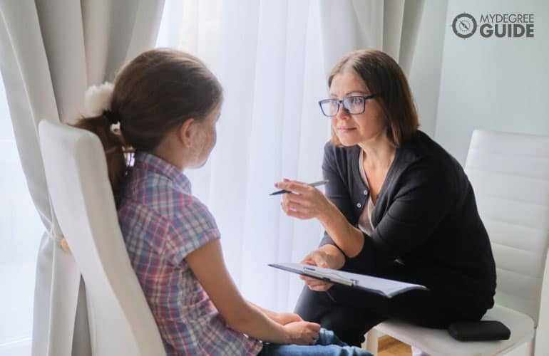 counselor talking to a female child