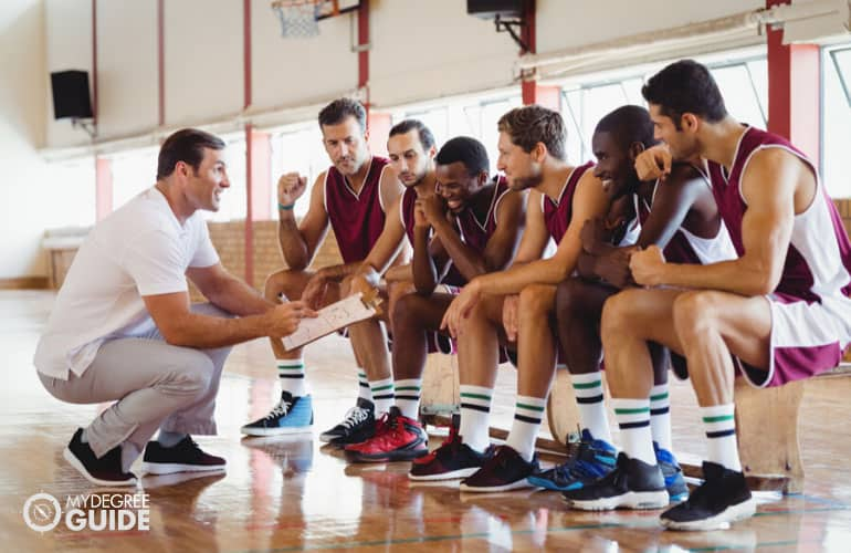 basketball coach talking to his team