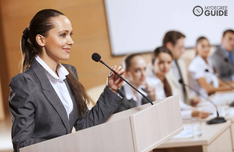 female manager speaking in public during a conference