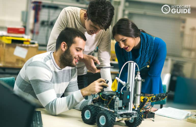 young computer engineers testing a robotic project
